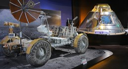 The Museum's Lunar Rover and Apollo Command Module on view in the Space: Exploring the New Frontier exhibit.