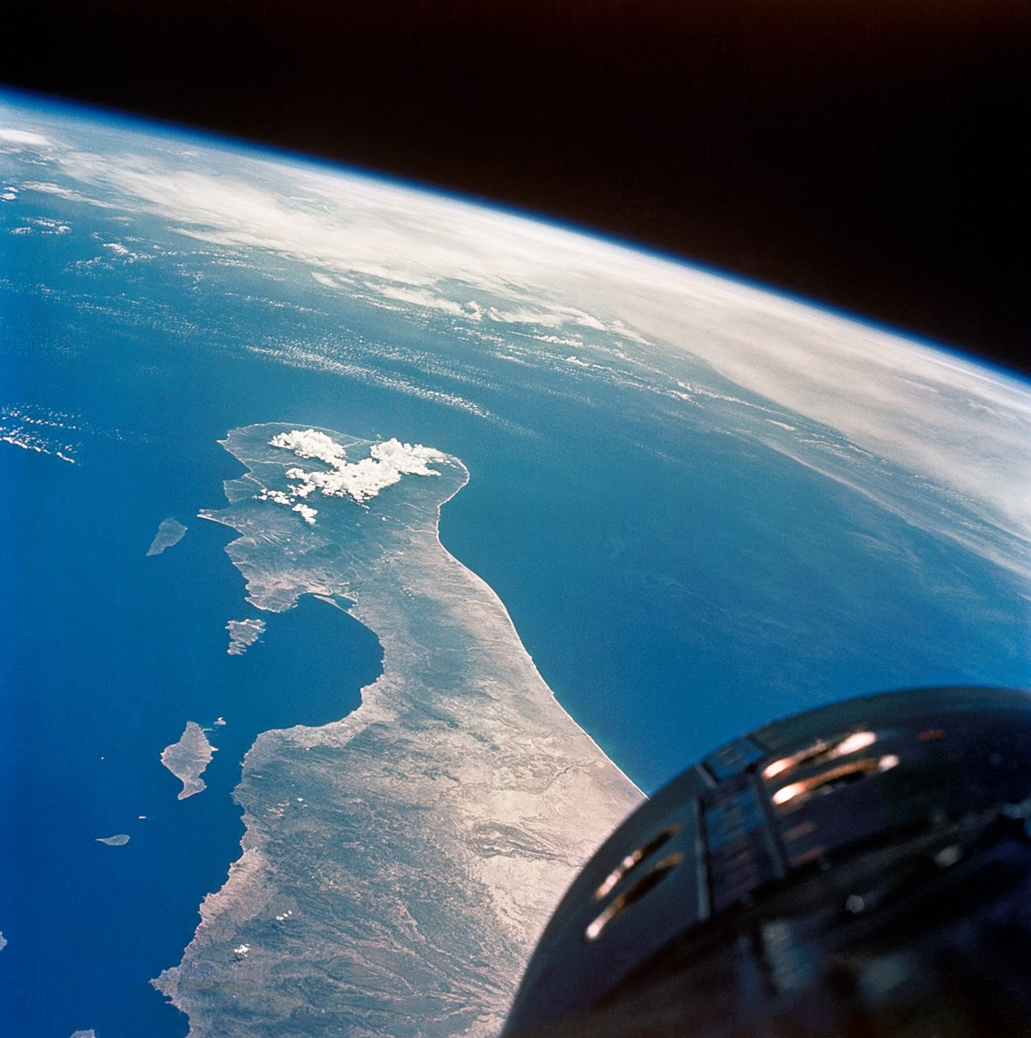 View of the Earth past the nose of Gemini V -NASA