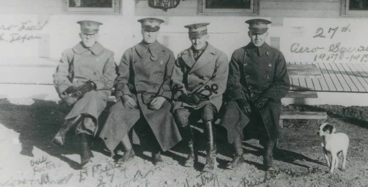 Executive officers of the 27th Aero Squadron and a dog at Camp Taliaferro Field, December 14, 1917.