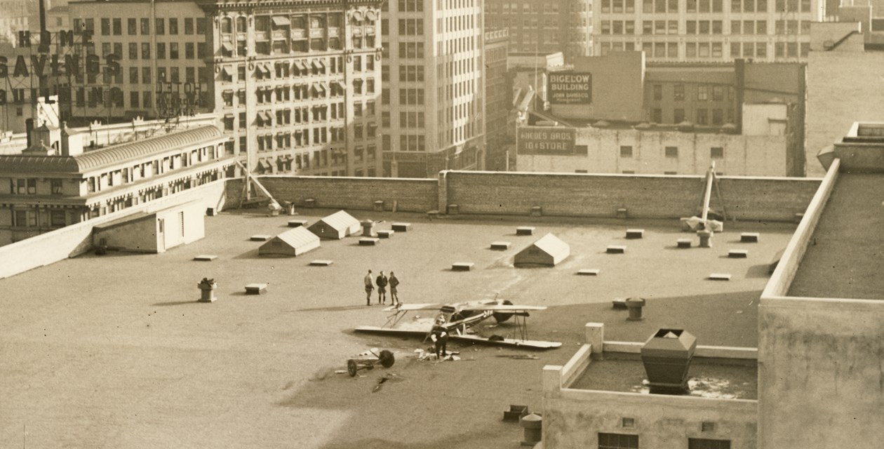Blum-1 - Alan Blum's plane on the roof of the Bon Marche building in Seattle after being forced to make an emergency landing.