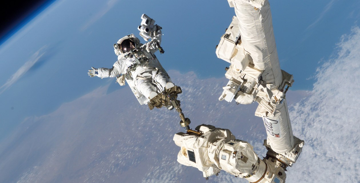 Ask the Ambassador - NASA Astronaut Stephen Robinson anchored to the Canadarm2 Credit: NASA