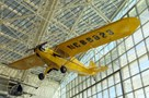 The Museum's Piper J3C-65 Cub on display in the Great Gallery