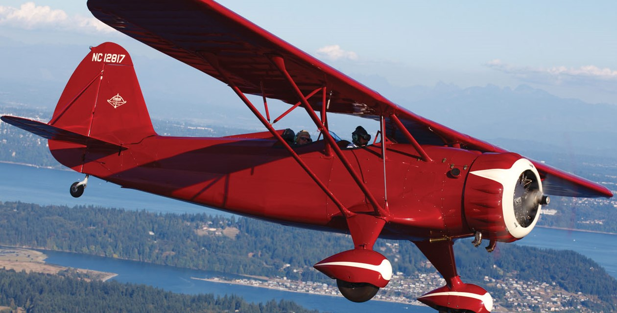 The Museum's Stinson Model O in flight. Photo by Jeremy Dwyer-Lindgren.
